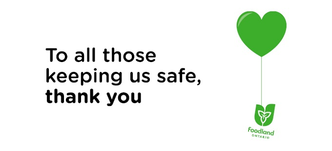 The image has a white background with black text and on the right side a green heart balloon is tethered to the Foodland Ontario logo. The text reads: To all those keeping us safe, thank you.