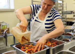This is a picture of foodservice staff preparing a Beef and Vegetable Stew for hospital patients in the kitchen at Grand River Hospital located in Kitchener. The stew features Ontario beef from VG Meats and Ontario root vegetables from other local farms.