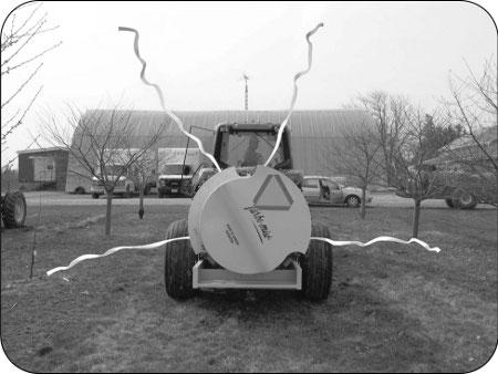 This photograph shows how ribbons tied to the highest and lowest nozzle position on the boom can indicate where spray-laden air will go when the fan is engaged.