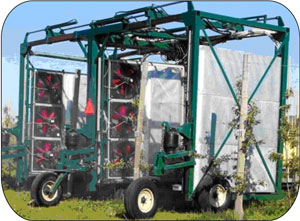 Figure 6. This is a photo of a customized recycling sprayer spraying dwarf apple trees.