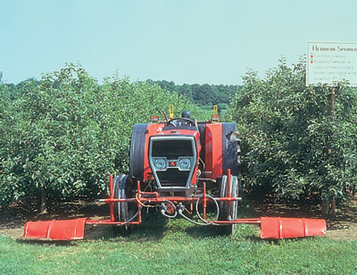 Figure 4-185. Mount shields to protect nozzles from wind and prevent drift - an added benefit is protecting low branches from herbicide