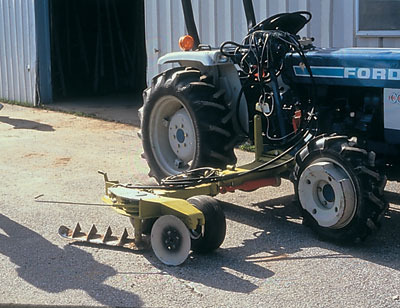 Figure 4-187. Use mowers with wing arms to cut weeds around tree trunks - a sensor kicks out the mower arm around the tree to prevent mechanical injury