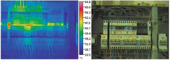 The image on the left shows a thermographic picture (uses colour to indicate hot spots) to show the hot spots on an electrical panel in a livestock barn.  The image on the right is a normal picture of the same electrical panel in the livestock barn.
