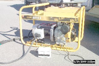 Portable generator with plug-in voltage frequency meter.