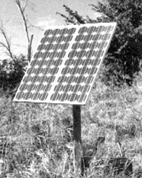 Photo of a solar panel providing power to a water pump.