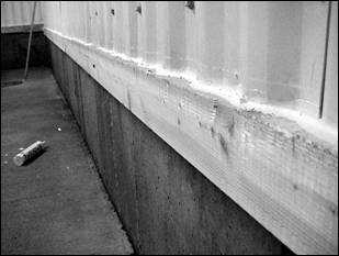 Caulking of joint between wall cladding and sill plate to prevent moisture damage (Source: Agviro, Inc.)