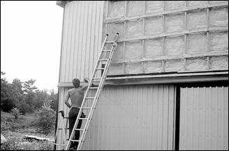 Outside-In technique of insulating a wall using Polyurethane Foam Insulation (Source: Agviro, Inc.)