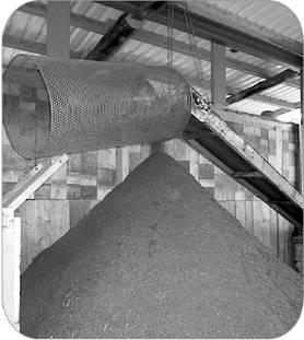 This image shows a conveyor at the end of the digester with a nutrient-rich compost by-product.