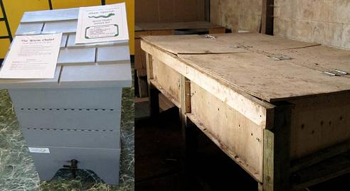 Figure 2 has two photos. The left photo 2A shows a five-layered rectangular light grey coloured plastic device. The dimensions are about 0.5 m wide x 0.5 m wide x 0.75 m high (18 in x 18 in x 30 in). The top layer is the lid, resembling a shingled roof. The second, third and fourth layers underneath are removable bins with slots near their tops likely for aeration. The bottom layer has legs for the other layers to sit on, plus it has a drainage tap on its side. The right photo 2B shows a long plywood box about 2.4 m x 0.4 m high (8 ft x 16 in) sitting on legs about 0.6 m (2 ft) high. The box has two hinged lids that can be flipped upwards to gain access inside.