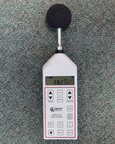 This picture is a close-up view of an integrating/logging sound meter displaying the sound level in the author's office of 38.2 dBA.