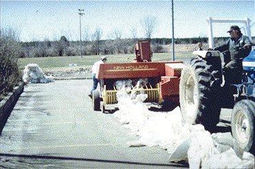 Windrow of plastic being baled.