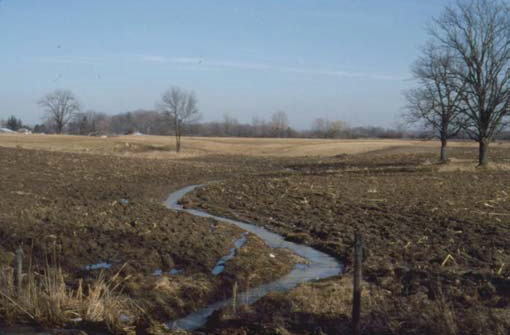 A private ditch or channel across a low area is not usually considered to be a natural watercourse.