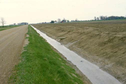 Municipalities are not obliged to dig their road ditches deep enough to outlet tile drains, although these ditches often provide excellent outlets. Permission from the municipality is required.