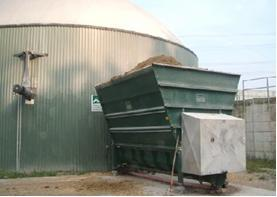 Hopper holding corn silage to be fed into digester.
