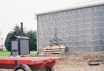The solar wall on the Veldman farm workshop helps reduce winter heating costs.