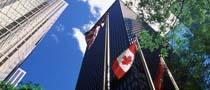 tall buildings and Canadian flag