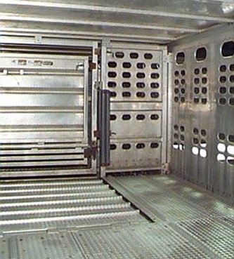 Picture of a livestock safety cushion installed beside a door in a livestock tractor trailer