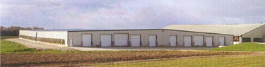 Low-profile, cross ventilated (LPCV) barn also known as a wide-body barn, this eight-row-wide freestall design takes up less space and can be better ventilated than two four-row naturally ventilated barns built side-by-side.