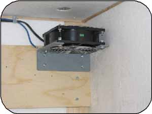 Photo 9. A 4-inch axial fan is mounted at the top right of the warm box.