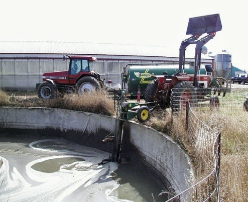 Outdoor liquid manure holding facility.