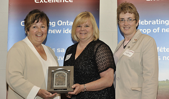 Carol Mitchell, Minister of Agriculture, Food and Rural Affairs, Laurie Nicol, and Judy Dirksen