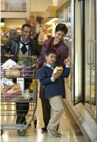 A family buying groceries in a supermarket